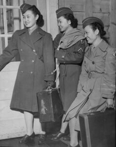 Three women carrying suitcases