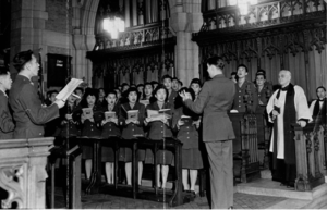 Choir of men and women being led by instructor