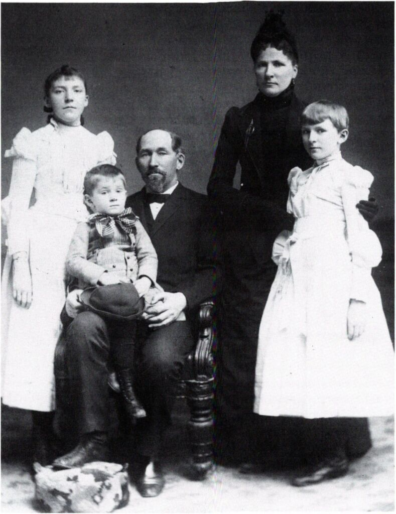 Ada Comstack (left) with her family as a young girl