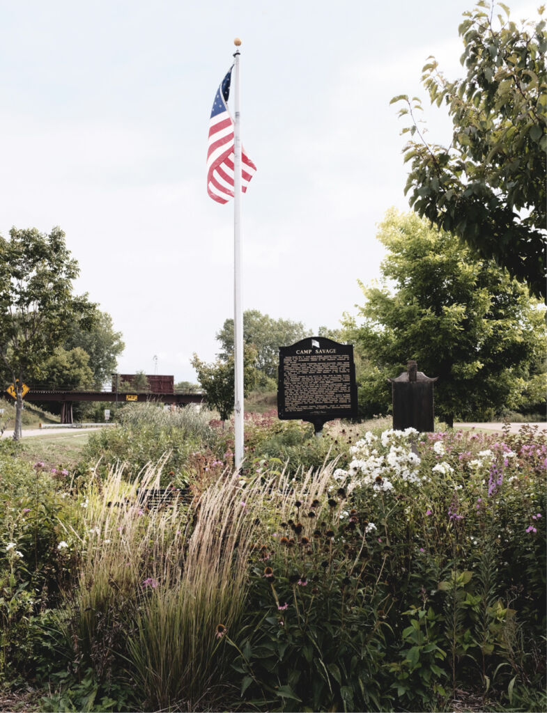 American flag next to sign
