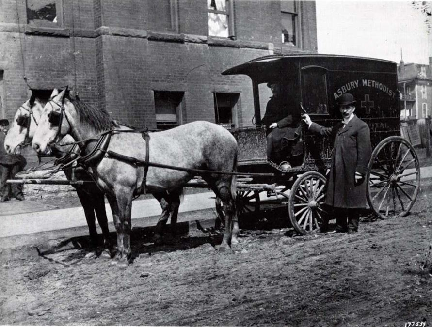 a 2 horse drawn carriage and 1 man