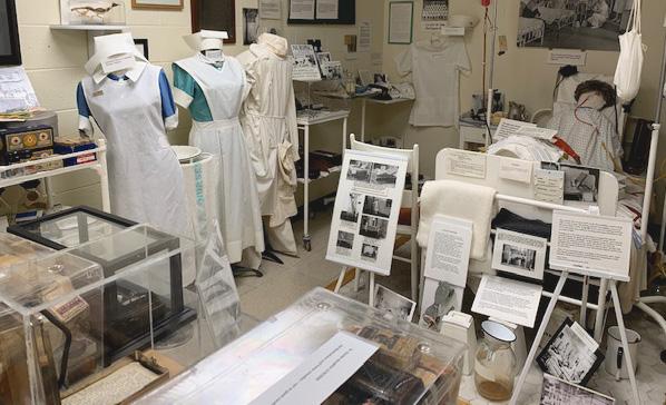 Hospital room set up with nurse uniforms on mannequin