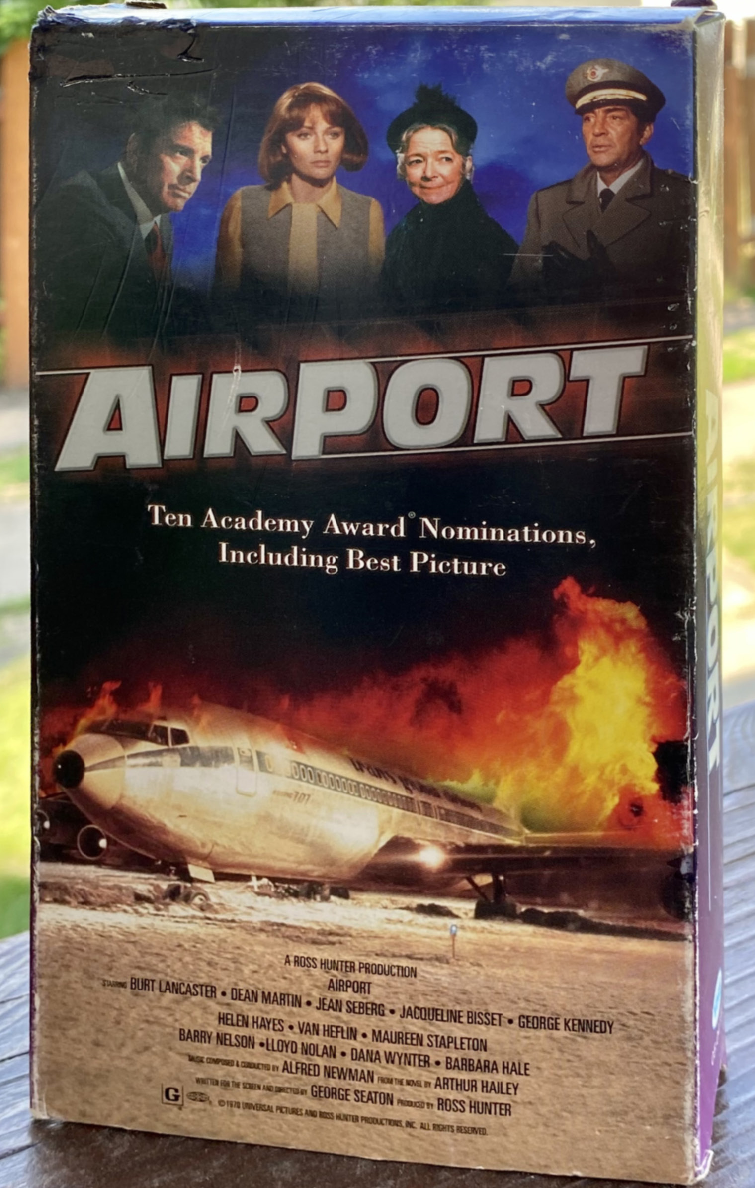 VHS cover with 4 people and an airplane on fire