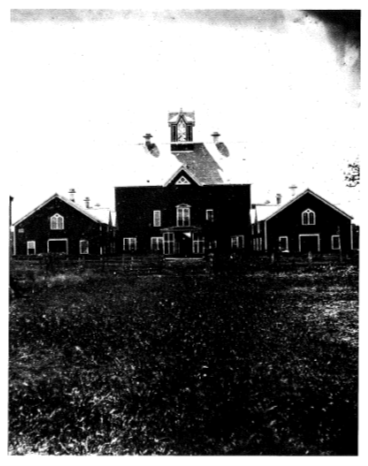 Black and white image of front entrance of a building