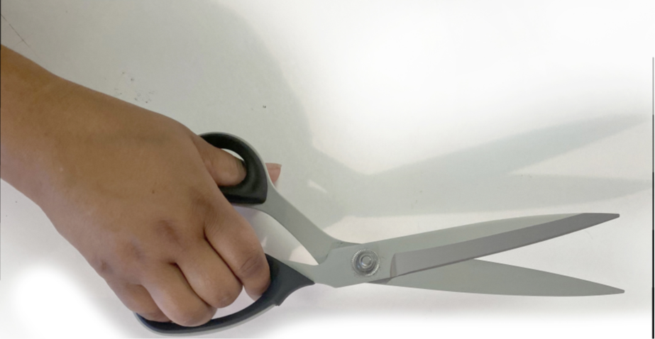 Hand with pair of scissors